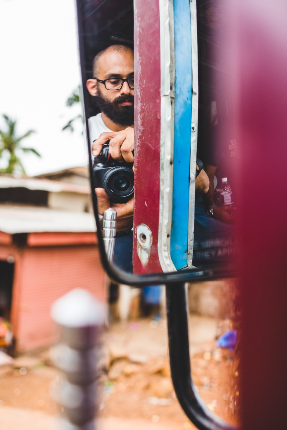 Photographer's self-potrait in the rear-view mirror